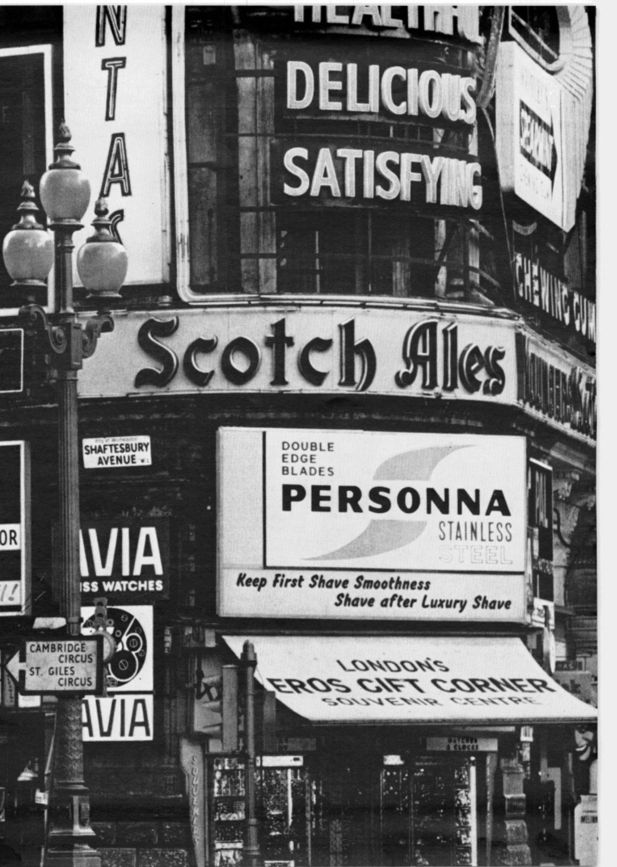 Photograph of a building on a street corner crammed with a myriad of lettering and signage.